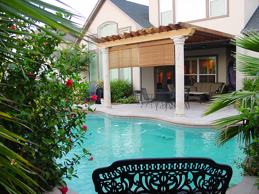 Cantera Stoneworks pergola web banner with image of backyard pool deck & cantera stone pergola.