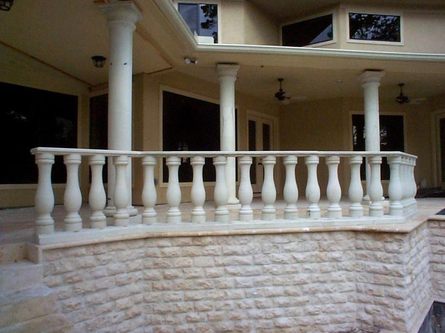 Cantera Stoneworks balustrad web banner with image of home with cantera stone balustrad, columns, & window surrounds.