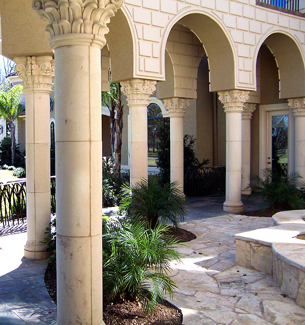 Cantera Stoneworks column web banner with image of home with cantera stone Corinthian columns.