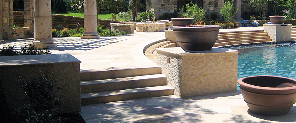 Cantera Stoneworks pool coping web banner with image of backyard cantera stone pool coping & arbor.