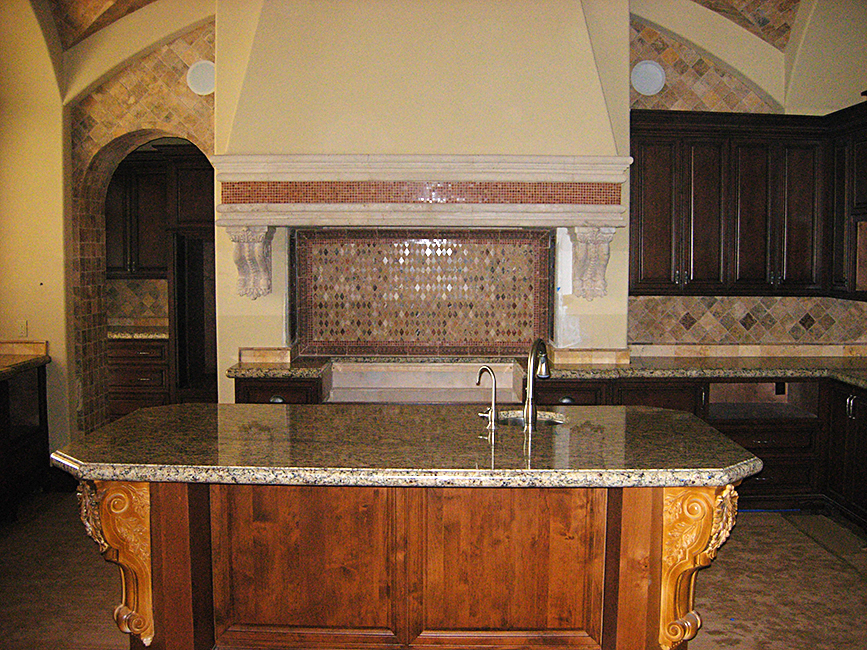 Cantera Stoneworks range hood web banner with image of kitchen with cantera stone range hood.