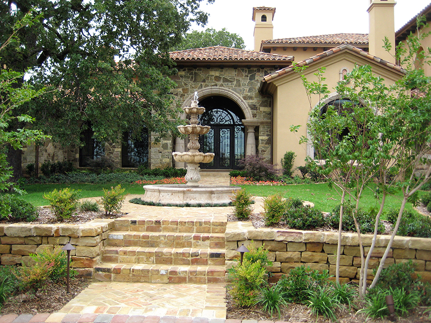 Cantera Stoneworks tier fountain web banner with image of home with cantera stone 3-tier fountain, door surround, & windows surrounds.